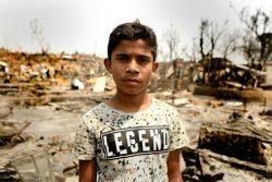 コックスバザールのバルカリ難民キャンプで起きた火災により、自宅や学習教材などの持ち物をすべて失った12歳のジュナイドくん。(2021年3月23日撮影)