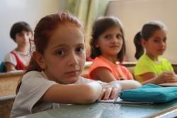 ユニセフが支援する夏の補習授業に参加するアレッポの子どもたち。