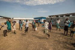 On 27 October 2015, children play during the school break in UNICEF supported primary school yard in Malakal Protection of Civilians site (PoC), Malakal, South Sudan. 470 children attend from grades 1 through 6. The school has five classrooms and seven teachers who teach English, Social Science, Christian Religious Education, and Mathematics. Due to the lack of space in the PoC, the same classrooms are used for CFS activities in the afternoon.  On 17-18 February 2016, the primary school was burnt down in fighting that left at least 18 people dead.