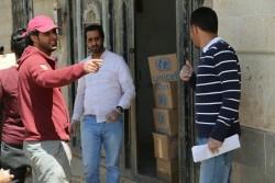 ユニセフの支援物資の箱が積み上げられています(10月20日撮影)。