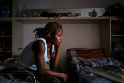 "[PHOTOGRAPHER'S CAPTION, NOT FINAL. DO NOT DISTRIBUTE] Mary, 18, from Benin City, Nigeria, at a safe house for victims of sex trafficking run by the Penelope association on the outskirts of Taormina, Sicily, Italy on April 27, 2017. When she was seventeen, Mary escaped a life with no prospects in Nigeria to work in Italy, but was deceived by traffickers into becoming a prostitute. On her journey she was raped by the trafficker, and on arrival in Italy she confessed that knew she was going to be used in the sex trade, giving authorities the opportunity to extract her from the ring. ""There is no hope in Nigeria,"" Mary says, ""I suffered a lot there, I don't have anyone to help me. I couldn't go to school. My father is dead to me, I have no siblings, so I had to work as a house girl looking after a woman's babies and cleaning her house. I was so frustrated and didn't know what to do, and my friend said I should go to Europe. I don't have anyone to rely on in Nigeria, and I decided to go."" ""Though my country is sweet and I love it, I suffered too much. There was no future there for me. A woman said she would help me and send me to Europe and she introduced me to a man, his name is Ben, who she said could help me. Ben said he knew people who had restaurants to put me to work in. For the moment, he said he would pay my expenses.  ""The next day, the man called me to his house."" Mary says. ""There were lots of boys and girls there. He said to all of us, if we made it to Europe, we all had to each pay €25,000. Some people said no, but I said that was okay.""  ""Then he took us to a place they do juju."" Juju is an ancient Nigerian belief system in the occult and through witches, spells are be cast on girls to ensure they fear for their lives should they escape. ""We had to swear to an old woman –a sorcerer– that we wouldn't run."" Mary explains. ""So, on March 17, I left for Libya. That place is very very bad. They treated us so"