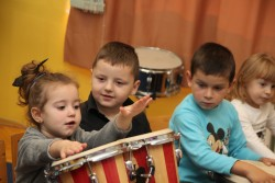 """Children can feel the rhythm too, because it's not just the ears that hear"", said the teacher Amina at the Center for Hearing and Speech Rehabilitation Sarajevo (Bosnia and Herzegovina), while children are enjoying the rhythms. Children are playing drums and percussion instruments gathered around teacher Amina who sets the rhythm playing the biggest drum while an Indian melody is playing from the loudspeakers. Some of the children can't hear, some have speech problems, while others have combined disabilities. UNICEF in Bosnia and Herzegovina has learned about this story through the contest for employees in preschool institutions who have made remarkable contributions to inclusiveness and quality of pre-school education. The goal of the contest was to identify and promote good practices and to share gained and applied experiences."