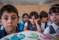 モスルにあるユニセフが支援する学校に通う子どもたち(2017年6月12日撮影)