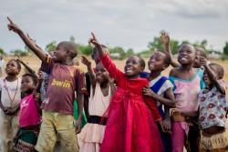 On 28 June 2017, children look on excited at the testing of unmanned aerial vehicle (UAVs) or drones by the UNICEF Innovation Team at the Kasungu Aerodrome in Kasungu in central Malawi. The Government of Malawi and UNICEF are launching a drone testing corridor to assess potential humanitarian use of UAVs. The corridor is the first in Africa and one of the first globally with a focus on humanitarian and development use. The launch of the UAV testing corridor follows a pilot project in Malawi in March 2016 on the feasibility of using drones for the transportation of dried blood samples for early infant diagnosis of HIV. On 29 June 2017,  the Government of Malawi and UNICEF launch an air corridor to test potential humanitarian use of unmanned aerial vehicles (UAVs), also known as drones. The corridor is the first in Africa and one of the first globally with a focus on humanitarian and development use. It is centred on Kasungu Aerodrome, in central Malawi, with a 40km radius (80km diameter) and is designed to provide a controlled platform for the private sector, universities and other partners to explore how UAVs can be used to help deliver services that will benefit communities. The UAV corridor will run for at least one year, until June 2018. Since the announcement in December 2016, 12 companies, universities and NGOs from around the world have applied to use the corridor. This includes drone manufacturers, operators and telecom companies such as: GLOBHE (Sweden) in collaboration with HemoCue and UCANDRONE (Greece), and Precision (Malawi), all of which were present at the launch to demonstrate connectivity, transportation and imagery uses respectively. UAV technology is still in the early stages of development. UNICEF is working globally with a number of governments and private sector partners to explore how UAS can be used in low income countries. All projects adhere to a strict set of innovation principles, with a focus on open source and user-centered design.