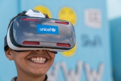 On 19 January 2017 in Jordan, Mansoor,12, watches the virtual reality documentary 'Clouds over Sidra' with a big grin, outside a UNICEF-supported Makani centre in the Za'atari camp for Syrian refugees, in Mafraq Governorate, near the Syrian border. The short film shows a day in the life of Sidra, an adolescent girl living in the camp – where more than half of the 80,000 population currently is comprised of children.  Primero is an open source technology platform enabling governments, aid agencies and social service workers to provide life-saving services and conduct case management for most vulnerable children was launched by key players in the humanitarian sector including UNFPA, UNHCR, the International Medical Corps, International Rescue Committee, and UNICEF in February 2017. Primero was created as a case management tool that enables social workers in the field to manage children displaced by conflict and provide them with a means to access basic services including family reunification in their host communities. In response to humanitarian crisis Primero is preparing for scale in humanitarian settings in host communities Lebanon, Jordan and the Kakuma refugee camp in Kenya. Primero is also being adapted and deployed for the case management of most vulnerable children in non-humanitarian contexts, more broadly. It is a highly configurable web application and mobile app that can run on a laptop, a privately-hosted server, or in a managed cloud environment enabling case workers on the move in refugee camps and in remote locations. As an open source tool Primero's code is publically available and encourages further application for children in communities displaced by conflict and crisis, and in other populations at risk of violence and exploitation.