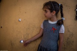 """Our house has these too, "" Abrar said as she points to the bullet holes in the door. ""I like to study. School is nice,"" says this second grader.  Farahedee School for boys and girls was rehabilitated by UNICEF. Now, 1,500 children attend the school, where they take classes and receive Mine Risk Education sessions. While many of the children are from east Mosul, increasing pressure has been put on the school as an influx of students from west Mosul have arrived and enrolled at the school."