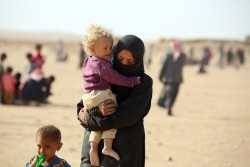 On 26 October 2016, following the on-going hostilities in the northern Iraqi city of Mosul, newly arrived refugees on the way to the Al-Hol camp, close to the Iraqi border in Syria's north -eastern Hasakeh Governorate.  In late October 2016, following the on-going hostilities in the northern Iraqi city of Mosul, more than 900 people including children arrived in Syria in the last few weeks seeking refuge at Al Hol camp, 14 kilometers from the Iraqi border in Syria's north -eastern Hasakeh Governorate.  This brings the total number of Iraqi refugees in Al-hol camp, including those arrived earlier in 2016, to nearly 4,600 people.   The newly arrived refugees are mostly mothers, children and elderly.  Mothers arrived with large bags filled with clothes, while older children carried their younger siblings looking exhausted and weak from the long journey. UNHCR has already installed 300 tents in Al-Hol camp to receive the refuges. Additional 1,000 tents are being set up to accommodate the displaced Iraqi families.  This week, UNICEF will commence trucking water and installing water storage tanks in the camp;  distribute hygiene kits, nutrition supplies to refugee families and provide psychosocial support services to children and their care-givers.