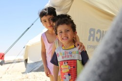 On 19 June 2017 in the Al-Hol refugee camp established for Iraqi refugees in the Syrian Arab Republic, Rimaz (left), 6, shelters in a tent. Rimaz's family fled their home in Deir-ez-Zor in the Syrian Arab Republic almost three weeks ago due to the violence. The family left empty handed.  They arrived in Al-Hol after travelling for 13 hours. ÒWe had to pay a smuggler to assist us to flee,Ó said RimazÕs father. ÒWe left in the middle of the night, we were scared because of attacks and landmines on the road,Ó he added.  Following an escalation in violence in Deir-ez-Zor, many are seeking safety in the Al-Hol refugee camp. UNICEF is responding to the needs of the displaced and refugee children and their families by trucking 300,000 liters of drinking water daily and distributing much- needed family hygiene kits to more than 20,000 Iraqi refugees and 340 Syrian internally displaced people. UNICEF has also installed latrines, shower units, water tanks and is finalizing the installation of an underground sewerage network.  UNICEF-supported mobile health clinics continue to provide medical assistance to children and mothers at the camp, including immunization services and malnutrition treatment and prevention through providing micronutrients and nutritional supplements. To help children cope with the trauma they have witnessed, UNICEF also supports four child-friendly spaces at the camp, where children participate in recreational activities as a form of psychosocial support. UNICEF also provided 17 tents to serve as learning spaces for children at the camp and distributed school bags and supplies to help them continue their learning.