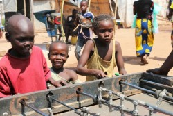 Bangui, Nov 13, 2015: Children play table football in Bangui's airport Mpoko camp for internally displaced persons. During the summer of 2015 security had started to improve in town and the site was slowly getting ready to be shut down. A new outburst of violence in Sept and Oct led to new displacements.assistance to cash assistance. It is an empowering and dignified form of support to children and their families, with a positive effect on the local economy and with lower administrative costs.