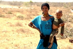 A mother carries her child as she walks in the drough-stricken Badanrero village in Moyale, Marsabit County, Kenya, Friday 3 March 2017. The onset of a severe drought in 2016 has hit arid and semi-arid regions in Kenya, affecting over 2.7 million people. UNICEF is supporting the Government of Kenya in initiating and implementing emergency response efforts by delivering life-saving assistance to affected households, strengthening coordination activities, assisting in monitoring of vulnerable groups and in advocacy. The latest figures as of the end of February 2017 show that 2.7 million people need water, sanitation and hygiene (WASH) assistance, 1.1 million children are food insecure, while over 100,000 children under 5 need treatment for severe malnutrition. An additional 174,000 children are out of school as a direct result of the drought. Through partnerships with key stakeholders, children in 23 arid and semi-arid land (ASAL) counties are continuing to benefit from nutrition preventative and treatment services, healthcare, WASH interventions, education and child protection services. By January of 2017, UNICEF had dispatched 12,000 cartons of essential Ready to Use Therapeutic Foods for the treatment of 12,000 severely- malnourished children. In addition, to enable access to water, county governments across the country are being supported to rehabilitate broken down boreholes as households are provided with water purification commodities as well as soap and jerry cans. So far over 90,000 children under 5 years, including breastfeeding mothers are receiving medical services as a result of medical supplies reaching health facilities in time.