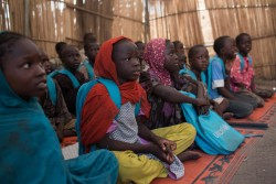 [Draft caption] Children attend school in the town of Banki, which was recaptured by the Nigerian military in 2015 from Boko Haram, in Banki, Nigeria, 28 September 2017. For more than 8-years, Boko Haram related violence has devastated the lives of families and in particular children across northeast Nigeria. Nearly 1 million children have been displaced by the crisis and around 20,000 people killed, amid horrific violations of child rights. Children who have been killed, maimed and abducted, widespread sexual violence and the forcible recruitment of women and children as 'human bombs'.  Attacks on children, as well as children forced to carry out attacks, are so common that they are almost expected or accepted as part of the conflict.  UNICEF's Deputy Executive Director, Justin Forsyth, visits Maiduguri, northeast Nigeria, from 27 September to 29 September 2017. On the trip, Forsyth visited a UNICEF supported clinic, providing inpatient therapeutic care in Maiduguri town. The clinic is providing critical support to children affected by severe acute malnutrition, including an intensive care unit. With Maiduguri hosting so many displaced persons, there is a serious strain on health services. Forsyth met a one month old boy who had been left in a bag by the roadside. Some people thought the baby was a bomb. However, Aisha a mother of seven other children realized it was a baby and rushed the boy, who is now named Mohamed, to the clinic. She is now the surrogate mother.    Banki on the border with Cameroon, has been almost been completely destroyed and now houses thousands of displaced persons who have gathered at a camp for their own safety and to access basic services. In Banki, Forsyth went to a UNICEF supported primary health care clinic that is helping to treat children with severe acute malnutrition, saving many lives. He also sat in on a class at a temporary school set up to provide some opportunities for children to resume school and have some fun a