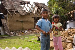"(Left) Iker, 9, and his sister Yeimire, 6, stand outside their home which was destroyed in an earthquake in San Andrés Hueyapan, Tetela del Volcán municipality, Morelos, Mexico, Thursday 21 September 2017. Neither Iker or Yeimire is attending school at the moment, because the building was destroyed in the earthquake. As of 23 September 2017, nearly 5,100 schools have been damaged or destroyed in Mexico following two powerful earthquakes that struck less than two weeks apart, threatening access to education for thousands of children.  Some seven million children live in areas affected by the earthquakes on September 8 and September 19.   ""We are deeply concerned by the substantial damage sustained by schools in the hardest hit communities and the impact this could have for children,"" said Christian Skoog, UNICEF Representative in Mexico.  ""It is essential that we find urgent solutions to get them back in the classroom as quickly as possible, both to secure their futures and to help restore a sense of normalcy to their lives following these traumatic experiences.""   UNICEF is working with its partners in areas affected by the earthquakes to establish temporary schools, promote school safety guidelines, train teachers in psychosocial support, and distribute education supplies and early childhood development kits to teachers and caregivers."