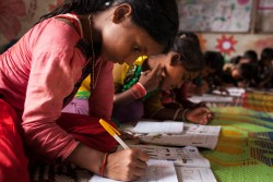 [Draft Caption]   At the Projapoti Child Learning Centre at 10 years old Sehera Begum does her English alphabet class.  She's from Balukhali, Maungdaw in Myanmar. It has been 9 years since she first arrived and started living at Kutupalong Makeshift Camp in Cox Bazar. By 5 September 2017, more than 146,000 Rohingya refugees fled across the border from Rakhine State, Myanmar, into Cox's Bazar district, Chittagong Division in Bangladesh since 25 August. As many as 80 per cent of the new arrivals are women and children. More than 70 000 children need urgent humanitarian assistance. More than 100,000 of the newly arrived refugees are currently residing in makeshift settlements and official refugee camps that are extremely overcrowded while 10,000 newly arrived refugees are in host communities. In addition, 33,000 arrivals are in new spontaneous sites, which are quickly expanding.  While some refugees are making their own shelters, the majority of people are staying in the open, suffering from exhaustion, sickness and hunger. Cox's Bazar district of Bangladesh is one of the most vulnerable districts, not only for its poor performance in child related indicators but also for its vulnerability to natural hazards.  Most people walked 50 or 60 kilometers for up to six days and are in dire need of food, water and protection. Many children are suffering from cold fever as they are drenched in rain and lack additional clothes. Children and adolescents, especially girls, are vulnerable to trafficking as different child trafficking groups are active in the region. Many more children in need of support and protection remain in the areas of northern Rakhine State that have been wracked by violence. In Bangladesh, UNICEF is scaling up its response to provide refugee children with protection, nutrition, health, water and sanitation support. With the recent influx of refugees, demand has increased and UNICEF is working to mobilize more support and strengthen its existing activit