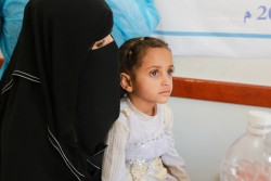 On 12 July 2017 at the Alsonainah Health Centre in Sana'a, Yemen, Reham, 10, has acute watery diarrhoea/suspected cholera and is treated with oral rehydration solution. In October 2016 cases of cholera in the city of Sana'a were announced by Yemeni health authorities. In April, this cholera outbreak began to spread rapidly and widely across Yemen. Between 27 April and 12 July, 326,082 cases of acute watery diarrhoea/suspected were reported along with 1743 associated deaths have been reported from 292 out of 333 districts. Acute watery diarrhoea caused by cholera or other infections can result in severe dehydration which can rapidly result in death unless treated quickly and properly. This health crisis is a consequence of two years of heavy conflict. Collapsing health, water and sanitation systems have cut off 14.5 million people from regular access to clean water and sanitation, increasing the ability of diseases to spread. At the same time, there is a shortage of doctors and nursing staff to help treat and care for those affected. There are no longer any doctors present in 49 of the country's 333 districts. Some have fled the country and those who have stayed have not been paid for more than ten months.  With Yemeni authorities WHO, UNICEF and other partners are racing to bring this outbreak under control. We are working to detect and track the spread of the disease and reach people with medical treatment, safe water and adequate sanitation and hygiene practices. WHO and UNICEF are supporting 626 diarrhoea treatment centres and oral rehydration therapy corners across the nation in the most affected districts, with a plan to further scale up to a total of 1156 such facilities. Since 27 April, WHO & UNICEF have provided more than 4 million sachets of oral rehydration solution, 828 000 bags of intravenous fluids, 1025 beds with cleaning supplies and 158 kits containing supplies for the treatment of cholera and diarrhoeal diseases.