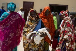 On 4 November 2016 in Maiduguri, Nigeria, newly-reunited families receive care packages from UNICEF and partners in a transit center for women and children that had been held by the Nigerian military for questioning. In November 2016, north east Nigeria remains in the grips of a humanitarian emergency.  An ongoing conflict between Boko Haram and the Nigerian military has resulted in 7 million individuals in desperate need of assistance across Borno, Gombe, Yobe and Adamawa states. Approximately 55% are children.  In collaboration with the government and humanitarian partners, UNCEF is providing life saving services across both north-east Nigeria and the wider Lake Chad Basin (Cameroon, Niger and Chad).  In Nigeria alone, primary health care services have reached over 3 million people with hundreds of thousands of children receiving psychosocial support, therapeutic feeding, access to safe water and education.