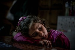 Mariem, 8, a refugee from the Syrian Arab Republic, in her family's shelter in Pikpa Village, an open refugee camp run by volunteers outside of Mytilini, Lesvos, Greece, Tuesday 14 March 2017. Mariem lives in the informal camp with her younger brother Omar, 4, and her parents. Pikpa was established in 2012 by volunteers and today hosts up to 100 refugees in a community like atmosphere. The Greek Islands are being used by the European Union as containment facilities for refugees escaping war to prevent them from traveling further into Europe. Today there are 15,000 people trapped on the island, and 66,000 across Greece. As of March 2017, one year after the closure of the Western Balkans migration route, irregular movements within Europe continue, but refugee and migrant children, whether alone or with family members, are increasingly facing higher fences, stricter border control and regular push-backs. Most recent concerns have been raised around new legislation in Hungary, prescribing for detention of asylum-seeking children above 14 years of age for migration control purposes. UNICEF continues supporting child protection services in 11 Child and Family Support Hubs (Blue Dots) in open reception facilities on the mainland and in urban sites in Athens, Thessaloniki and Ioannina. Since the beginning of 2017, 1,341 children (including 507 newly registered in February) benefitted from services on regular basis.  Vulnerable refugee and migrant families and children continued benefitting from specialised psychological and mental health services in Athens and five open sites in Attica region (Elefsina, Elliniko, Agios Andreas/NeaMakri, Rafina and Elaionas).  UNICEF's ongoing partnership with the Office of the Greek Ombudsperson for Children on child rights monitoring continued in February, including organizing visits to Skaramangas and Lesvos, as well as continuous advocacy with the Ministry of Migration and the Ministry of Education on issues related to UASC and