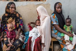 Mothers sit with their malnourished children as they wait to be seen by medical personnel at the Dalaram Clinic in Maiduguri, Borno State, Nigeria, Thursday 27 July 2017. The prolonged humanitarian crisis in Nigeria's northeast has had a devastating impact on food security and nutrition, with 5.2 million people currently in need of food assistance in the three most affected states and 450,000 children under five in need of nutrition  support. This has been compounded by the lean season, which runs from July to September. Between January and July 2017, a total of 66,607 children aged 6-59 months suffering from severe acute malnutrition (SAM) were admitted into the outpatient therapeutic program (OTP) through 332 facilities supported by UNICEF across Borno, Yobe and Adamawa states. UNICEF continues to scale up delivery and quality of the humanitarian response to affected populations in coordination with the Government, other United Nations agencies, and non-governmental organizations (NGOs).