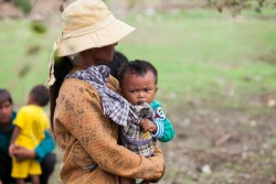 On 28 May 2016 in Viet Nam, a mother carrying her baby in Tra Co village of Ninh Thuan province to attend the triggering session as part of the Community-led Total Sanitation supported by UNICEF, In Tra Co village, two-third of the villagers defeat in the open, causing high incidences of water and hygiene borne diseases among the villagers. This in turn contributes to the high rate of malnutrition of children under five years old in the community. Following a visit to Viet Nam in May 2016, internationally acclaimed singer-songwriter and UNICEF Goodwill Ambassador Katy Perry is calling for increased focus on children being left behind in one of AsiaÕs fastest growing economies. Katy Perry was in rural Ninh Thuan province, among the poorest and most remote regions of Viet Nam. She visited UNICEF programmes aimed at ending exclusion for children with disabilities, and also saw the organization's work in education and early childhood development; water, sanitation and hygiene; and climate change, in a particularly challenging environment. In 2016 in Vietnam, poverty traps families in intergenerational cycles of deprivation, many of the country's most vulnerable children and families now have to deal with the effects of climate change. A lack of access to clean water and sanitation, combined with long periods of drought, means children are even more prone to malnutrition and disease. By World Bank classification Viet Nam has now 'graduated' to become a lower middle income country. However, rampant and pervasive poverty, especially among children in rural areas, stands in sharp contrast to the progress evident in cities. Circumstances beyond a child's control continue to deny some of them a fair chance to realize their potential. Continued support is required to reach out to the children left out but as the country advances economically, international donors are focusing on trade and on developing business opportunities, leaving some social and development areas