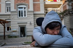 "Sajad Al-Faraji, 16,  sits at a refugee housing center in a former abandoned seniors hospital in Heitzing, a suburb of Vienna, Austria on September 7, 2017. By late November 2015, refugee and migrant flows into Europe remained at an unprecedented high. Since the beginning of the year, over 870,000 refugees and migrants have crossed the Mediterranean Sea to Europe. Many of them are escaping conflict and insecurity in their home countries of Afghanistan, Iraq, Pakistan and the Syrian Arab Republic. More than one in five is a child.  Sajad Al-Faraji, 16, who fled conflict in Basra, Iraq with his brother, Zein Alabdien Al-Faraji, 14, his sister, Houda Al-Malik 26, and his mother Mona Al-Hammoudi, 56, lost the use of his legs during an operation on his lower back when he was one month old in Iraq. His family arrived in Vienna in late 2015 after a harrowing trip through the Balkans.  A year after arriving in Austria, Sajad was accepted into a school.  In September 2017, the family are still waiting for an interview from the authorities to begin their asylum process in Austria. Sajad is deeply frustrated, and as an escape, he spends between two and three hours a day playing games on his phone. ""I didn't know about Europe, but now I've met so many people, and seen many things, and I'm one step closer to my dreams. My dream now is to finish school and learn very good German. I want to be with the Austrian people, I want to work as a chef, I want to travel."" Sajad said, pausing, ""I want to have a life like others."" Please see the series noted below for photo documentation of Sajad over the two-year period: 2015 - https://weshare.unicef.org/Folder/2AMZIF3TGC6  2016 - https://weshare.unicef.org/Folder/2AMZIFIPAIS1  2017 - https://weshare.unicef.org/Folder/2AMZIFIPAB32"