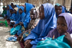 Children attend class in a temporary learning space in Muna Garage IDP camp, in Maiduguri, Nigeria, 29 September 2017. For more than 8-years, Boko Haram related violence has devastated the lives of families and in particular children across northeast Nigeria. Nearly 1 million children have been displaced by the crisis and around 20,000 people killed, amid horrific violations of child rights. Children who have been killed, maimed and abducted, widespread sexual violence and the forcible recruitment of women and children as 'human bombs'.  Attacks on children, as well as children forced to carry out attacks, are so common that they are almost expected or accepted as part of the conflict.  UNICEF's Deputy Executive Director, Justin Forsyth, visits Maiduguri, northeast Nigeria, from 27 September to 29 September 2017. On the trip, Forsyth visited a UNICEF supported clinic, providing inpatient therapeutic care in Maiduguri town. The clinic is providing critical support to children affected by severe acute malnutrition, including an intensive care unit. With Maiduguri hosting so many displaced persons, there is a serious strain on health services. Forsyth met a one month old boy who had been left in a bag by the roadside. Some people thought the baby was a bomb. However, Aisha a mother of seven other children realized it was a baby and rushed the boy, who is now named Mohamed, to the clinic. She is now the surrogate mother.    Banki on the border with Cameroon, has been almost been completely destroyed and now houses thousands of displaced persons who have gathered at a camp for their own safety and to access basic services. In Banki, Forsyth went to a UNICEF supported primary health care clinic that is helping to treat children with severe acute malnutrition, saving many lives. He also sat in on a class at a temporary school set up to provide some opportunities for children to resume school and have some fun again. The three schools in the town were destroyed