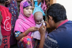 21 December 2017.  A Rohingya woman holds her little girl as her upper arm is measured to determine whether she is malnourished at a UNICEF-supported outpatient nutrition center in Thae Chaung village in Central Rakhine, Myanmar. Rakhine state has long been among the poorest in Myanmar, and the indicators for children are poor. Since the round of violence that started in 2012, things have not improved for children. Background: https://www.unicef.org/media/media_102378.html