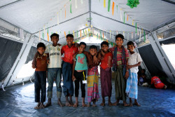 Rohingya refugee Omer Faruk, 8, (fourth from left) stands with new friends he has made at a UNICEF-supported child-friendly space in the OO expansion zone of Kutupalong makeshift settlement in Ukhia, Cox's Bazar, Bangladesh, Thursday 28 December 2017. Omer and his eldest brother fled for their lives from their home in Rakhine State in Myanmar. The whereabouts of three of Omer's siblings are unknown and his parents passed away after becoming ill. By 20 December 2017, an estimated 655,000 Rohingya refugees had entered Bangladesh to escape the recent escalation of violence against them in Rakhine State in Myanmar. More than half of them are children. The influx of refugees, which resumed following attacks at Myanmar Border Guard Police posts on 25 August 2017, has resulted in a critical humanitarian emergency, with many Rohingya in dire need of life-saving assistance. Thousands of refugees continue to arrive each week, taxing already heavily stretched resources. The inter-agency Humanitarian Response Plan (HRP) for 2017-2018 identified water, sanitation and hygiene (WASH), health, nutrition and food security and shelter as areas for immediate scale-up to save lives in both settlements and host communities. As per the HRP, the Rohingya population in Cox's Bazar is highly vulnerable, many having experienced severe trauma, and are now living in extremely difficult conditions. Given the current population density and poor sanitation and hygiene conditions, any outbreak of cholera or acute watery diarrhoea, which are endemic in Bangladesh, could kill thousands of people residing in temporary settlements. Urgent nutrition needs have been prioritized for children under age 5 (including infants), pregnant and lactating women and adolescent girls. These include close to 17,000 children under 5 suffering from severe acute malnutrition to be supported over the next six months. Nutrition sector partners plan to cover 70 per cent of the identified needs in the makeshift and n