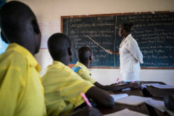 On 8 March 2017 in South Sudan, a teacher goes over English grammar with students during a lesson, in UNICEF-supported Torit One Primary School in Torit County in Eastern Equatoria State. A UNICEF Back to Learning Initiative begun in 2015 in partnership with the Ministry of Education is helping to increase children's access to education in the country, where prolonged conflict has disrupted children's schooling and the ongoing crisis has put added strain on the country's already weakened education system. Countrywide, about 51 per cent of school-aged children are out of school, and just 40 per cent of girls have access to education. UNICEF is supporting efforts aimed at providing 300,000 children between the ages of 3 to 18 – including 135,000 girls – with access to education in 2017.