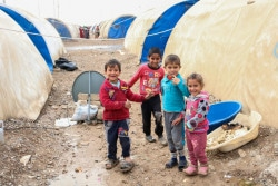 Children in Hamam al-Alil camp remain displaced from their homes.  UNICEF is providing winterization assistance, including warm clothes, boots and scarves for children in addition to regular education, child protection and WASH activities.