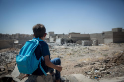 "On 7 August 2017 in Iraq, Akram, 6, looks at the destruction in west Mosul. ""I don't know if things will go back to how they were before,"" said Akram.  As of 11 September 2017, across Iraq, more than 5 million children are in need of assistance as heavy fighting intensified including in Mosul and recently in Tel-Afar."