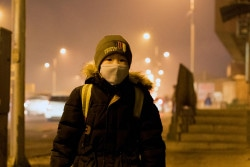A boy waiting for his bus to a local school in Songinokhairkhan district where the air pollution level is dangerously high.
