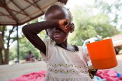 Maria John, 2, who has been diagnosed with severe acute malnutrition, drinks a ration of therapeutic milk, which is rich in nutrients and easy to digest, at a UNICEF supported inpatient stabilization centre in Al Sabbah Children's Hospital, Juba, South Sudan, Thursday 19 October 2017. When Maria was first admitted to the inpatient centre she weighed just over 6 kilograms.