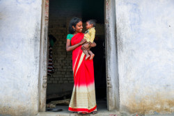 Village: KARODHI,  Block: JAMUA,  District: GIRIDIH, State: JHARKHAND Country: India,  24th DECEMBER 2016 .  A young mother watches as representatives from Jago foundation do door to door visits to parents of adloscent girls and boys disuccing the evils of child marriage and its legal implications, encouraging them to educate their children in the village of Karodhi, in Jamua block of Giridih.  Giridih district has one of the highest rates of child marriage in India where 6 out of 10 girls are married before 18 years. UNICEF Jharkhand in partnership with the Jago Foundation has launched a pilot programme to make 65 villages 'child marriage free' in the district. The programme trains over 500 adolescent girls in the pilot villages. Around 70 adolescent boys and girls groups have been formed under the project. It includes empowerment of adolescents through formation of groups, engagement with religious and caste leaders, awareness generation in villages through folk media and street theatre, formation of village child protection committees, pledge by parents in villages, orientation of stakeholders like block development officers, anganwadi wokers, ASHA, school teachers, etc.    UNICEF India/2017/Prashanth Vishwanathan Prashanth Vishwanathan's coverage in Jharkhand district - Giridih , Block - Jamua  against Child Marriage .  UNICEF Jharkhand in partnership with the Jago Foundation has launched a pilot programme to make 65 villages 'child marriage free' in the district.