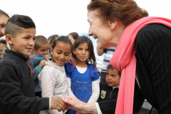 In Baalbek, Lebanon on 8 March 2018, (right) UNICEF Executive Director Henrietta H. Fore engages with children as she visited Lebanon with (unseen) UNHCR High Commissioner Fillippo Grandi. The UNICEF and UNHCR Chiefs, on a joint visit to Lebanon as the world celebrates International Women's Day and as the Syria conflict nears its seven-year mark, heard direct testimonies from some of the women and girls who were forced to flee the war and seek safety in neighbouring Lebanon. With women and girls making up more than half of the registered Syrian refugee population in Lebanon, and with nearly 40 per cent of refugee households in the country headed by women, Filippo Grandi, the UN High Commissioner for Refugees, and Henrietta H. Fore, Executive Director of UNICEF, called for stronger action to protect and empower women refugees.LEBANON/BAALBECK, March 8, 2018 UNICEF Executive Director Henrietta Fore visited Lebanon with UNHCR High Commissioner Fillippo Grandi. In an informal tented settlement they met with refugee children and women. During their encounter, the women brought up their living conditions in the settlement and the importance of the training they have been receiving, on prevention of gender based violence and child marriage, supported by UNICEF and UNHCR. These activities are intended to build the capacity of women and young girls to be active agents of change in their communities.