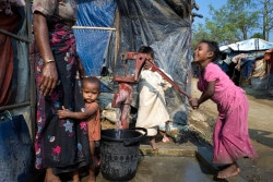 Rohingya refugees do their afternoon washing up at a water pump in Shamlapur refugee camp, Cox's Bazaar District, Bangladesh, Monday 5 March 2018. As of 25 February 2018, more than 671,000 Rohingya people have fled Myanmar and sought refuge in neighboring Bangladesh since an outbreak of violence began on 25 August 2017. UNICEF and its partners are working to provide for the needs of this enormous refugee population who will be all the more vulnerable during the upcoming monsoon and cyclone seasons.