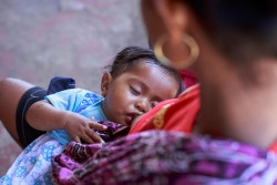 Marciana Do Santos (female) is breastfeeding her baby daughter Alifa while at the SISCA post in Balibo of Bobonaro Municipality, Timor-Leste. 18/10/17. Photo: UNICEF Timor-Leste/2017/bsoares