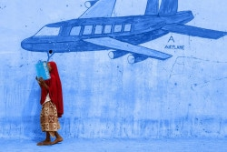 """[TREATED PHOTO] On 17 March, Alia, 10, covers her face with a folder while standing in front of a wall mural of an aeroplane, in a camp for internally displaced people, in Yola, the capital of Adamawa, a state in the country's north-east. When she still lived in her hometown, in the Local Government Area of Michika, word came on a Friday that members of the Boko Haram rebel group had attacked neighbouring villages. On the next day, the men arrived in her town. Her father was killed, but she, together with her mother and other family members, managed to flee to the town of Mubi, leaving all their belongings behind, but three months later, that town also came under attack. They then fled across the border to neighbouring Cameroon before slowly making their way back to Nigeria and ending up in the displacement camp in Yola, where Alia is attending a UNICEF-supported school. Her mother suffered from high blood pressure and diabetes before the attacks, and now she is very sick, adding to Alia's worries. Alia misses her father and her friends, and she is scared that attacks will occur again, but she refuses to give up hope. """"I want to be a nurse,"""" she said. """"I want to help people."""" The folder Alia is holding bears the UNICEF logo.In March 2015 in Nigeria, 15.5 million people, including 7.3 million children, are affected by the continuing crisis in the country's north-eastern region. More than 1.2 million Nigerians have fled their homes as a result of violence and attacks by Boko Haram insurgents that have escalated since the beginning of 2015. Many of the displaced, most of whom are children and women, are sheltering with in host communities that have limited resources, and in formal and informal camps. All are in urgent need basic supplies, health and nutrition services, and critical water sanitation and hygiene support to prevent the spread of disease. Over 150,000 people,– the vast majority children and women – have also fled to neighbouring Cameroon,"""