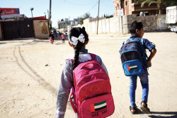 "(Right) Talal Abo Hosoun, 9, and Samira Abo Hosoun, 7, walk to school for the afternoon shift in Rafah, southern Gaza Strip, State of Palestine, Sunday 3 December 2017. Two-thirds of schools in the Gaza Strip operate on double shifts, because of a shortage of classroom space and a growing population. As a result, tuition time has been reduced to 4.5 hours a day, and extracurricular activities are no longer supported, making it difficult for children to access quality education. The Abo Hosoun family, comprised of father Mohammed, his wife Omayya and their seven children, live on the third-floor of a building in Rafah, in the south of the Gaza Strip. Like many families in the Gaza Strip, they face daily challenges. Children living in the Gaza Strip, a narrow strip of land on the Mediterranean Sea home to two million people (half of them children under the age of 18) face multiple challenges which leave them extremely vulnerable. Poverty is widespread and unemployment rates high: nearly 42 per cent in the Gaza Strip, one of the highest rates in the world, with unemployment reaching 60 per cent of youth, and 80 percent of the population relies on some kind of humanitarian assistance. Coping mechanisms are eroding fast, with some children and families resorting to negative strategies such as school drop-out, child labour and early marriage. Some 97 per cent of water drawn from the coastal aquifer in Gaza is now unfit for human consumption. The longstanding electricity and energy crisis dramatically reduces families' access to electricity and cooking gas - in December 2017, families only received 4 to 5 hours of electricity daily. By all estimates, unless major investments are made in the water sector urgently, Gaza will be ""unlivable"" by 2020. However every day, Palestinian children display inspiring stories of resilience and hope and many adolescents demonstrate astonishing skills and talents. UNICEF programmes in the Gaza Strip help children access the basic servic"