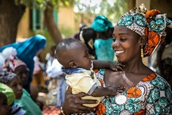 (Right) Tata Oulalé, a Mama Yeleen, holds her six-month-old son Mohamed, as she waits for him to receive vaccinations at the Baraouéli Health Center, in Baraouéli, Ségou region, Mali, Thursday 8 February 2018. The Mama Yeleen initiative, which is promoted and supported by UNICEF and its partners, trains women who act as model mothers in early childhood development (ECD) and good nutritional practices, and can therefore educate parents about best practices for the welfare of mothers and their children.