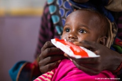 Gemechu Teteche, two years old, feeds on RUTF. Gemechu have come with his mother to the village health post for the weekly Outpatient Therapeutic Feeding Programme implemented by the village health extension worker with RUTF supplies provided by UNICEF with ECHO support. ©UNICEF Ethiopia/2017/Zerihun Sewunet