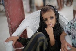 On 30 June 2018 in Yemen, a child waits as UNICEF-supported emergency humanitarian supplies are distributed in Hodeidah. In a statement by UNICEF Executive Director Henrietta H. Fore on 12 June 2018, UNICEF estimates that at least 300,000 children currently live in and around Hodeidah city. Millions more children throughout Yemen depend on the humanitarian and commercial goods that come through that port every day for their very survival. Without food imports, one of the world's worst malnutrition crises will only worsen. Without fuel imports, critical for water pumping, people's access to drinking water will shrink further, leading to even more cases of acute watery diarrhea and cholera, both of which can be deadly for small children.   There are 11 million children in need of humanitarian aid in this war-torn country.  UNICEF urges all parties to the conflict and all those who have influence over them to put the protection of children above all other considerations. Every effort must be made to keep children safe and to provide them with the health, protection, water, sanitation, nutrition and education services they desperately need.