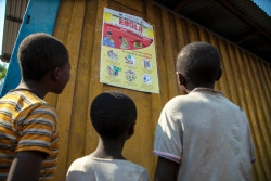 On 10 August 2018,  children read an Ebola-awareness poster in North Kivu, the Democratic Republic of the Congo (DRC). Following the 1 August 2018 announcement by the Government of the Democratic Republic of the Congo (DRC) of a new Ebola Virus Disease (EVD) outbreak in North Kivu, UNICEF has mobilized its teams to help contain the spread of the disease and protect children.  The impact of an outbreak on children can be far reaching. It's known from earlier outbreaks in the DRC as well as in West Africa that children can be affected in various ways. Children can themselves be infected by the disease, but the impact goes beyond; it impacts their families and communities as children can lose their parents, care-givers and teachers. Access to basic services such as health care and education can become severely compromised. Also, children who are infected or whose relatives are, face stigmatization and social exclusion.  The Congolese Government has activated its response plan and called its partners, including UNICEF, to participate in the response. UNICEF has deployed a team to Beni for the response, including health specialists, communication specialists and a water, sanitation and hygiene specialist from the Ebola-response team in the Province of Equateur. Health, water, sanitation and hygiene and communication supplies have been sent to the affected areas including 300 laser thermometers to monitor the health conditions of people in the affected region and 2,000 kg of chlorine to treat water to help contain the spread of the disease. As at 14 August 2018, UNICEF has installed 35 chlorination points, as well as handwashing units in 45 public places and in health facilities in the affected areas of Beni and Mangina in North Kivu.  UNICEF has supported the distribution of prevention posters and leaflets, and worked with communities, in public places and with local radio stations to promote safe hygiene and sanitation practices that help contain the spread of the