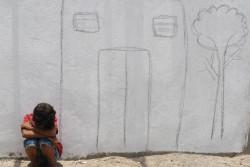 家族で住んでいた故郷の家を思う、国内避難民のアフマド君(13歳)。