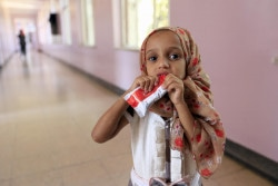 A small girl eats plumpy nut whilebeing treated for malnutirtion at a hostpial Sa'ana on November 2, 2018. With ongoing and unending conflict in Yemen, humanitarian situation continues to deteriorate across the country. There are over 400,000 severely malnourished children in need urgent lifesaving assistance in Yemen.  The country is on the brink of famine and children's chances of survival are becoming slimmer by the day.  UNICEF are working with partners around-the clock to save children suffering from malnutrition and disease.  We are currently working to reach: •	275,000 malnourished children with critical life-saving supplies and care •	Over 5 million people with safe and clean water to stop the spread of life-threatening diseases •	Nearly 1 million children with vaccines and healthcare  •	9 million people with emergency cash assistance to help families buy basic commodities so they can survive