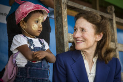 "On 29 January 2019 in Mynamar, (right) UNICEF Executive Director Henrietta H. Fore visits the Thet Kel Pyin Muslim Internally Displaced Persons (IDP) camp and meets with children from Temporary Learning Centre,at Thet Kel Pyin Camp in Sittwe, the capital of Rakhine state. On the left is Tin Tin Aye, 2.5 years old. In January 2019, UNICEF Executive Director Henrietta Fore urged Myanmar's authorities to invest in all children, to build a stronger, more harmonious society that will support Myanmar's progress and stability.  Fore, who just wrapped up a three-day visit to the country, met Government officials in the capital city Nay Pyi Taw, and children and families in Rakhine State. ""More than 120,000 children in Myanmar still live in squalid camps due to ongoing conflicts, with limited access to education, health, or protection services; at the same time 55 per cent of all children are living in poverty,"" Fore said. ""It is time to invest in the country's most vulnerable children, no matter their religion, ethnicity or citizenship status.""   Fore took that message to State Counsellor Daw Aung San Suu Kyi, and emphasized the urgent need to grant agencies regular humanitarian access, and to expand the coverage and quality of basic services for all children, including children in rural areas and those affected by conflict.  They also discussed the critical role that education can play in fostering social cohesion, peace and prosperity. Fore also met the Minister of Defense, Lieutenant General Sein Win.  She recognized the progress made in ending underage recruitment and use of children by the military, and urged that action plans be adopted to address other grave violations of children's rights.  She asked if the current ceasefire could offer opportunities for humanitarian access particularly in Kachin and Shan States. In Nay Pyi Taw, Fore attended the high-level forum 'Realizing Myanmar's Development Vision for Every Child'.  She highlighted th"