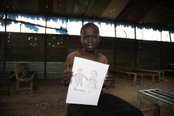 Falluoch Jeremia, 11, is holding a drawing of his parents whom he hasn't seen for two years. Last time they saw each other was when bullets were flying in Malakal. They got separated and haven't seen each other since. Caseworker Simon Char has just taken the boy's information and asked questions about his family. The information will go into the national database together with a picture of Falluoch and hopefully the parents are still alive and found. UNICEF and partners have reunified close to 6000 children since the conflict broke out in 2013. Still, over 12,000 children are waiting for family tracing and reunification.