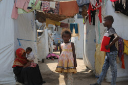 On 4 December 2018 at a camp for internally displaced persons in Aden, Yemen, a child stands outside of their temporary shelter. UNICEF Regional Director for Middle East and North Africa Geert Cappelaere visited Yemen on 4 and 5 December 2018. As of 30 October 2018, over 11 million children – 80 per cent of all children in the country – require humanitarian assistance, due to the impact of the ongoing conflict. Worsening years of underdevelopment, attacks against civilians and civilian infrastructure and lack of salary payments for most civil servants have pushed basic services for children to the brink. Children face food shortages, disease, displacement and an acute lack of access to basic social services. One out of three children in Yemen is at risk of acute malnutrition.