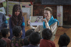 "On 25 February 2019 in Bangladesh, (right) UNICEF Executive Director Henrietta H. Fore interacts with children as she visits a Learning Centre in the Camp 18 section of the Kutupalong-Balukhali mega-camp in the Cox's Bazar district. In February 2019,  half a million Rohingya children are stateless refugees in the Cox's Bazar area in southern Bangladesh, increasingly anxious about their futures, and vulnerable to frustration and despair. The massive humanitarian effort led by the Government of Bangladesh with international support has saved countless children's lives. There is no viable solution in sight for these Rohingya children who live in the world's largest and most congested refugee settlement. The vast majority were forced to flee for their lives from Myanmar into Bangladesh in August 2017. In Myanmar, the majority have no legal identity or citizenship. In Bangladesh, children are not being registered at birth, they lack a legal identity, and they lack a refugee status. Until conditions in Myanmar lead to those eligible returning home, Rohingya children remain status-less minority. This excludes these children from learning a formal education curriculum and they are desperately in need of marketable skills. ""The obligation we have as a global society is immense: to give children and young people the world has defined as 'stateless', the education and skills they need to build decent lives for themselves,"" said UNICEF Executive Director Henrietta Fore, following a two-day mission to Cox's Bazar on 25-26 February with the United Nations Secretary General's Humanitarian Envoy, Ahmed Al Meraikhi. The results of a survey completed in December 2018 of 180,000 Rohingya childrenages 4-14 now enrolled in ""Learning Centers"" across the Cox's Bazar area show the extent of the need for education. More than 90 per cent were shown to have learning competencies at the pre-primary to grades 1-2 level. Just 4 per cent were at grade levels 3-5, and 3"
