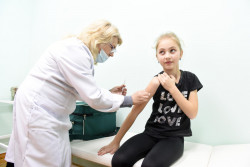 Maryana Dzuba, 9, receives her first dose of MMR vaccine on 21 February 2019 in the medical centre of the Lapaivka village school, Lviv region, Ukraine, as part of a three-week long catch-up vaccination campaign to increase MMR coverage among school aged children in the region. Photo: Yurko Dyachyshyn