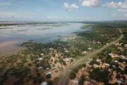 """Lilongwe, 11 March 2019 – UNICEF has stepped in to support thousands of families affected by floods in the southern region of Malawi. Preliminary estimates from the Department of Disaster Management and Preparedness (DoDMA) indicate that 93,730 families have been affected with 6,341 families displaced and seeking shelter, mostly in schools, churches and health centres. DODMA also states that 30 people have been confirmed dead and 377 injured as of 11 March 2019. With thousands forced out their flooded homes, many families lack basic supplies including food, water and sanitation facilities. The floods have also disrupted learning for thousands of children. """"In an emergency such as this, children suffer the heaviest impact and are at increased risk of malnutrition and disease."""" says Michele Paba, UNICEF Malawi Acting Deputy Representative. """"We are therefore providing water treatment supplies, cholera medicines and supplies, soap, buckets, and temporary latrines to be installed in the schools, churches and health centers where displaced families are being sheltered. We will be screening children for malnutrition and providing the necessary treatment,"""" adds Michele. UNICEF is also working with partners to ensure that primary and secondary school classes resume as soon as possible for affected children, so that their education is not disrupted. UNICEF will provide tents and school supplies to schools and temporary learning centres and will deploy additional volunteer teachers. With over 6,000 families displaced, there are also child protection risks. """"UNICEF is concerned about increasing vulnerability of violence against children and women, and the psychological well-being of children due to the disaster,"""" Michele Paba continued. """"Social welfare teams and community police need to be present at evacuation sites to provide direct support."""" UNICEF is also supporting DoDMA to assess the situation using drones. Drone acquired photos and videos of"""