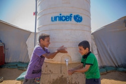 """""""We can't image out lives without water. It's really good that we have a water tank next to our tent."""" Mujbal and Mutaab are brothers who have been displaced from Al-Qaim, near the Syrian border, for almost a year. Anbar Governorate is the largest in Iraq, and has a significant population of displaced people due to ongoing armed conflict. UNICEF is working to implement its full range of activities, covering education, health and nutrition, child protection, water, sanitation and hygiene and emergency services to people in and out of camps."""